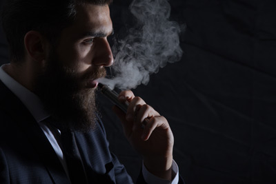 Businessman-smokes-cigarette